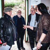 Elaine at the entrance with artist Verdiano Marzi, Patrick McQaire and president of 3 R Jean-Marie Burton