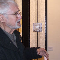 Brian Beale and Suzy Cox (exhibition coordinator) with 'She 2004'. Dorset County Museum, Private View
