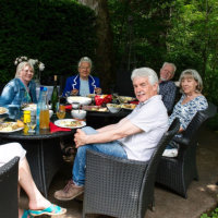 The artists and others having a relaxing lunch in the garden after the vernissage.