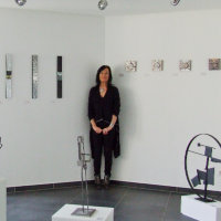 EMG in a corner of her 'Intimists' exhibition with sculptures by Olivier Jean Caloin, mediArt espace Gallery, 31 Grand-rue, Luxembourg City.