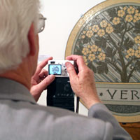 Robert Field photographing a mosaic in the Mosaic Museum of Briare. Gallery of the Musée d'Emaux et de Mosaïque, Briare, France